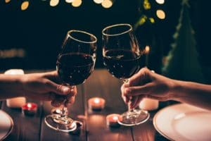 couple clinking wine glasses at Romantic Restaurants in Santa Fe